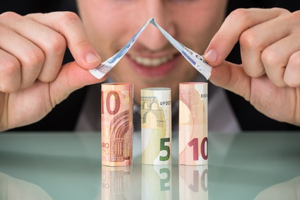 Close-up Of A Young Businessman Making House Of Banknotes